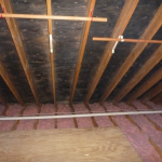 Water damage under the roof in an attic