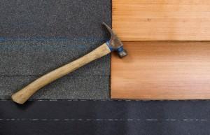 installing new roof shingles