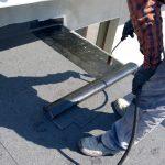 Man installing a flat roof