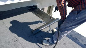 Man installing a flat roof