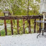 hailstones covering patio and backyard after spring storm