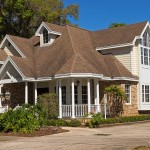 Image of a nice home in need of roof tear-off