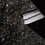 Rainy roof installation Warner Roofing