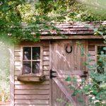Wooden garden shed with cedar shake shingles